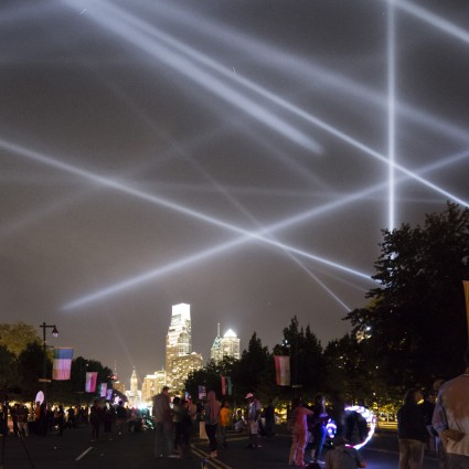"""Participants along the Benjamin Franklin Parkway look out on """"OPEN AIR"""" by Rafael Lozano-Hemmer from Eakins Oval"""