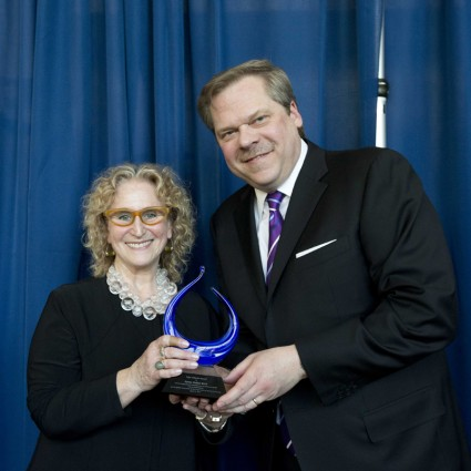 Penny Bach receives the award from Robert T. Stroker, Dean of the Center for the Arts and Vice Provost of the Arts.